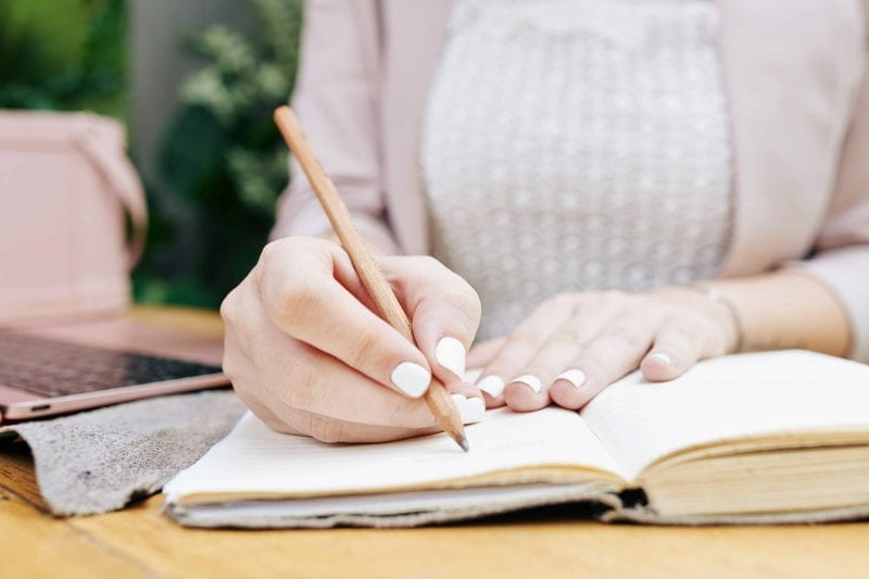 Best Planners for Mom - blog image writing in planner