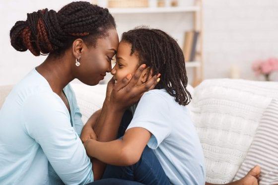 loving african american peaceful mom during corona virus pandemic