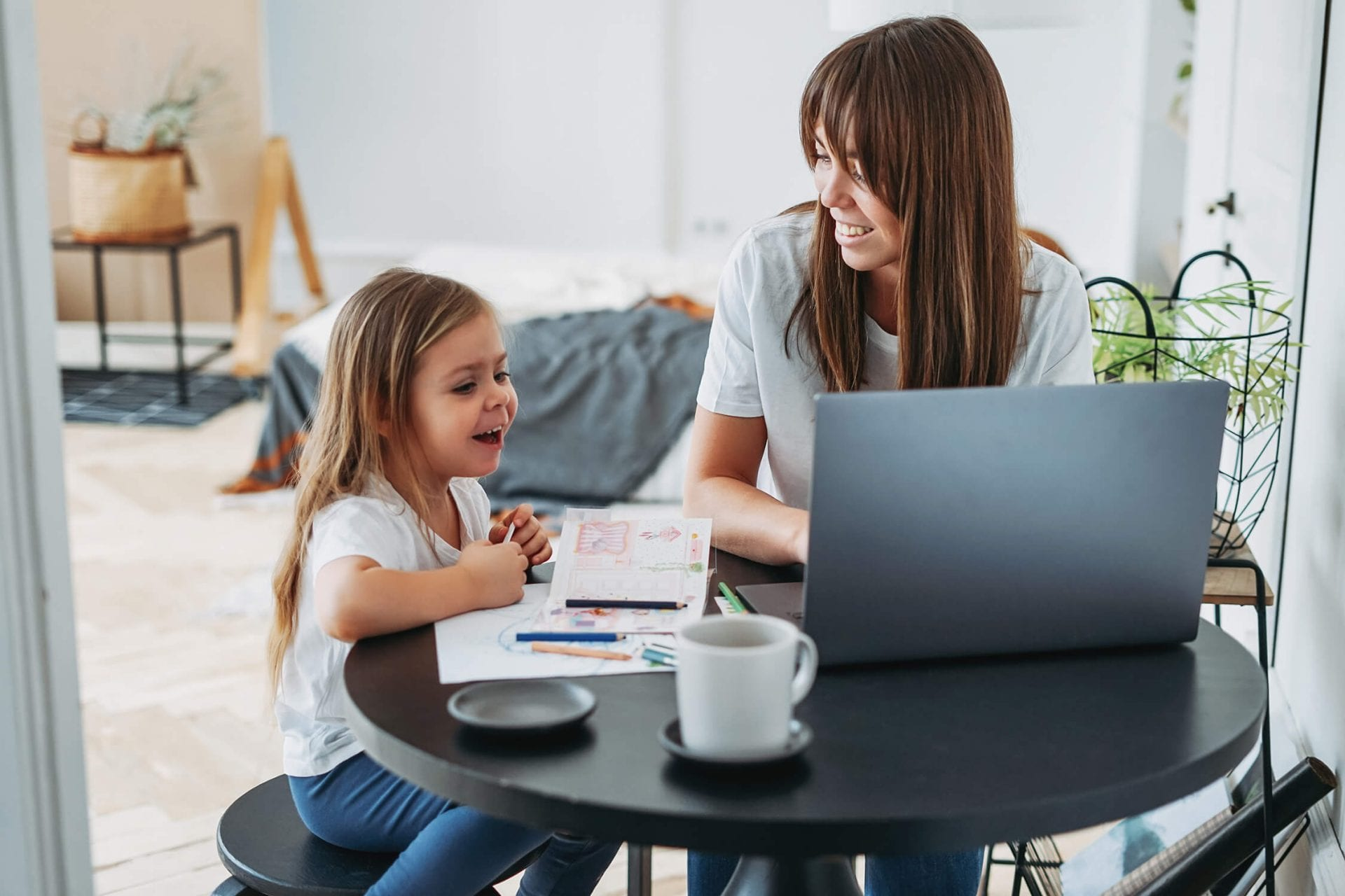 working-mom-freelancer-on-the-laptop-with-little-daughter