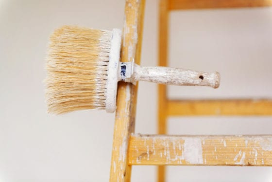 home-renovation-brush-on-a-ladder